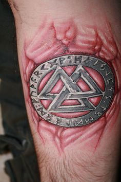 Fresh ink, next morning. Pic is self taken and I hope to get a better one up when it heals.    The design is a valknot surrounded by the eldar-futhark (i.e. entire norse runic alphabet.) which is a symbol of knowledge and power.    Tattoo by Tim Kern of Last Rites in NYC - Easy Branches