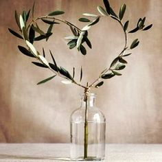 Olive branches are always classic for a wedding table decoration.