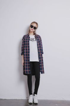 Long plaids are chic with black.