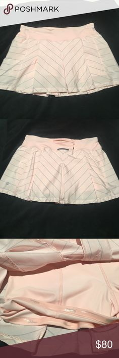 Lululemon size 6 Fast Cat skirt Excellent condition skirt with shorts attached. Missing tags but waist is 14.5 in across, front is 11.5 in, back is 12.5 in lululemon athletica Skirts