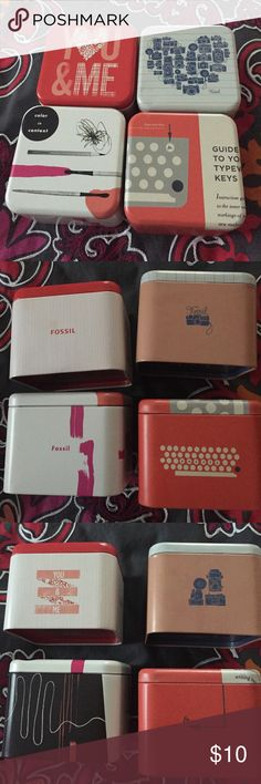 8 limited edition fossil watch tins Set of4 limited edition fossil watch tins to store your watches, jewelry and other items! Watch tins are the following themes: you & me love, photography/vintage camera, typewriter, paint & coloring Fossil Accessories Watches