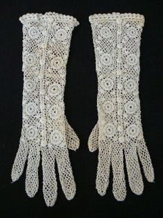 hand made crochet lace gloves .
