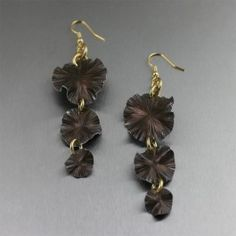 Three Tiered Brown Anodized Aluminum Lily Pad Earrings - Fun, festive, and fabulous. Looking for an earring that is beautiful, simple, and uniquely you? Your search is over. These Brown Anodized Aluminum Three Tiered Lily Pad Earrings boast a stunning hand-chased design that is classic with contemporary flair. Now, where's the party?