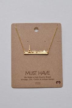 Back in stock! An adorable bar-like necklace showing the Paris skyline. Can you say amour?! - Length: approx. 16 inches.