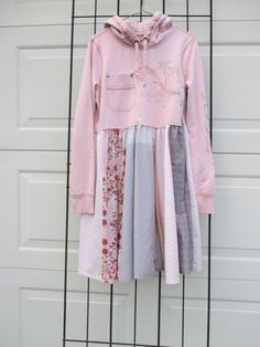 Cute Abercrombie & Fitch hoodie converted to a shabby tunic. Great distressed typography across bodice and left sleeve. Colors are pale pink and grey. All fabrics used are pre-loved and recycled. Used hems from original garments or serged/stitched cut edg