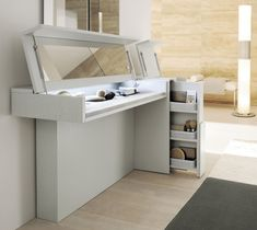 modern and stylish white dressing table with convertible top into mirror and sliding storage on wooden floor