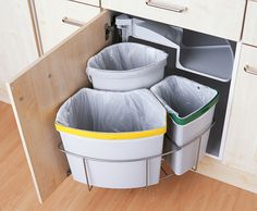 "Three-Section Swing 'Eco' Bin from ""Magnet Trade. Lids cover bins when cabinet is closed."