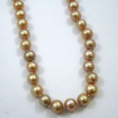 Pink Pearl Strand Necklace with 14K Yellow Gold Clasp. - $225