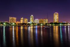 The skyline at night seen from Spa Beach Park, in St Petersburg, Florida Vancouver Skyline, Wall Art For Sale, Atlantic City, Google Images, New York Skyline, Saints, Spa, Florida, Night