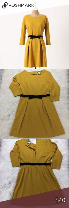 """Anthropologie Girls From Savoy Mustard Dress Large Flirty fit in a unique mustard yellow color with a velvet brown tie. Three-quarter back zipper. Made out of 75% Rayon, 20% Polyester and 5% Spandex. In good condition. Measurements: Bust- 46""""; waist- 24""""; Length- 35.5"""" Anthropologie Dresses Midi"""