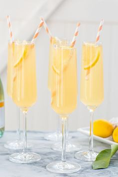 This delicious peach punch is so simple to make and based on the classic French 75 cocktail recipe. This sweet party punch is perfect for gatherings! Cocktails Champagne, Summer Cocktails, Cocktail Drinks, Cocktail Recipes, Alcoholic Drinks, Beverages, Sweet Cocktails, Summer Parties, Sangria