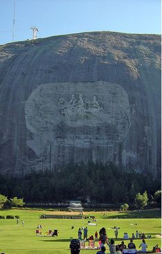 "The Confederate Memorial Carving, is the largest high relief sculpture in the world & depicts 3 Confederate heroes of the Civil War, President Jefferson Davis and Generals Robert E. Lee and Thomas J. ""Stonewall"" Jackson. The entire carved surface measures three-acres, larger than a football field and Mount Rushmore."