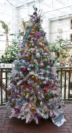 The coastal-inspired Christmas tree brightens the atrium and adds some unconventional flair, flamingos and all!