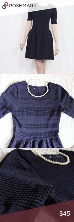 """Fit and Flare 3/4 Sleeve Stretchy Dress Gorgeous detailed boucle-type dress with 3/4 sleeves, a fit and flare silhouette, and circular neckline. Slip on styling, provides a good amount of stretch, and holds you in at the same time! In excellent gently used condition, though the inside tag is missing, along with the size. Model is 6', size 2/4, and fits her well, with a little room, therefore I've labelled this a size 4.   All measurements taken laying flat.  Bust: 16"""" Waist: 13"""" Hips: 20""""…"""