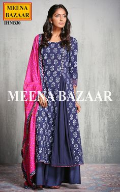 Get a perfect look wearing this Blue Cotton palazzo suit. Featuring batik floral prints all over with oxidized buttons on princess lines, it is also highlighted with inverted box pleated cut with a touch of pink gota lace.Comes with floral modal silk palazzo and silk bandhej dupatta with gota tassels.