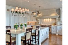 I LOVE this kitchen island that morphs into an eat-in kitchen space