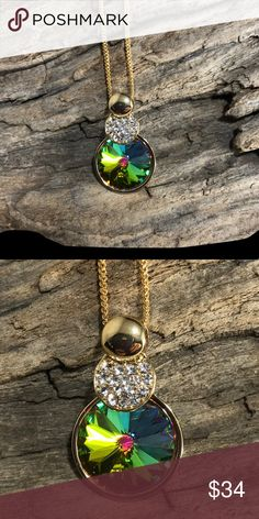 "Handcrafted necklace made with Swarovski crystal PRICE REDUCED!!! Petite Swarovski medium vitrail crystal stone in a beautiful gold-toned pendant. This is a lovely necklace if you like understated bling. It is about 3/4 inch in width w/ 16"" chain. My husband & I make our jewelry using genuine Swarovski crystals.  All items are brand-new and much prettier in person. Proceeds used to help our 5-year-old granddaughter Lila May in her fight against cancer, but she lost her battle.  Donations…"