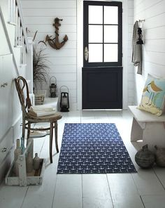 Anchor theme entryway with wall anchor and rug.