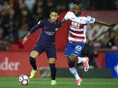 Neymar Jr of FC Barcelona (L) competes for the ball with Uche Henry Agbo of Granada CF (R) during the La Liga match between Granada CF v FC Barcelona at Estadio Nuevo Los Carmenes on April 02, 2017 in Granada, Spain.