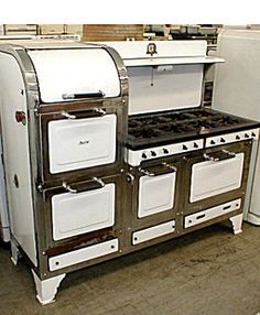 1929 Magic Chef 8 burner gas stove White and black enamel with nickel plated trim.