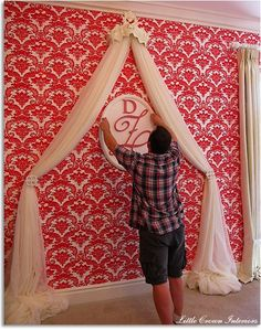 Great feature wall behind crib in baby's room - love the draped tulle for a faux curtain look.: