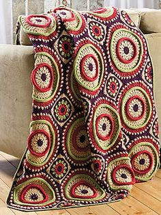 Awesome ring toss afghan.  I will probably never make this, but it kicks ass.