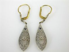 Art deco earrings set with two trilliant cut blue sapphires and twenty rose cut diamonds