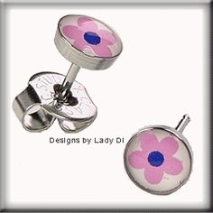 Just how adorable are these?   	  Pink Flower Daisy Studs Studex System 75 Ear Piercing Earrings Stainless Silver