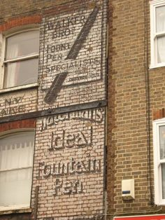 A ghost sign in London's Stoke Newington Church Street. The term is used to describe the remnants of adverts painted by hand directly on to the brickwork of buildings
