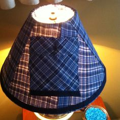 Covered an old lamp shade with a pair of old pajama's! Easy and super cute!