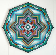Incredible Ojo de Dios... wow! I have this one- jays mandalas on etsy- he is a master ojo maker