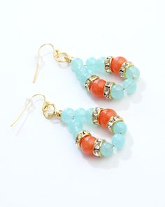 Vi Bella Jewelry - Jasmine Earrings - A statement piece to be reckoned with! The Jasmine Earrings consist of round natural jade beads dyed coral-orange, light sea foam blue glass beads, and bejeweled gold beads. Pair with the Jasmine Necklace.     Length:     Handcrafted by Vi Bella Artists in Mexico  $16.95