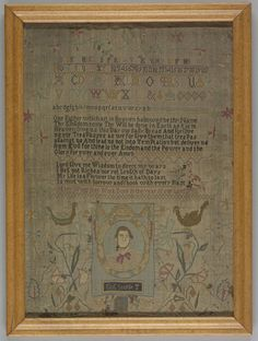 1782 Mary Wood Sampler embroidered in silk in black, blues, golds and pinks on a natural linen ground. Bands of alphabets and numerals in cross stitch and eyelet stitch, the Lord's Prayer, a verse, and at the bottom, a portrait of King George III in dense cross stitch. A floral vine border with fanciful birds.