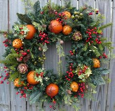 Christmas Fruit Wreath In this beautiful Christmas wreath, realistic fruit with cloves, pine and berries create a beautiful, classic look. People will be constantly touching this wreath wondering if the fruit is real! Average diameter: (tip to tip) Christmas Door Wreaths, Christmas Flowers, Holiday Wreaths, Christmas Holidays, Holiday Decor, Christmas 2019, Christmas Pumpkins, Christmas Berries, Southern Christmas