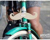 OMG WHY DO I NOT HAVE ONE OF THESE ON MY BICYCLE.
