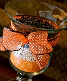 fall decor- easy, fill vases with fall color products and tie a ribbon around it!
