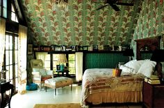 """Wallpaper can bring an unloved corner to life,"" she writes. ""Even the tiniest of squares can evoke a glamour of another time. The nook; under the stairs; the bookshelves; on a landing; on the ceiling of a bedroom. Wallpaper can bring out the unexpected by putting it in a place where it wouldn't usually be."""