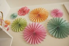 Paper pinwheels. These look easy to make, simple and cute decorations for girls room or party.