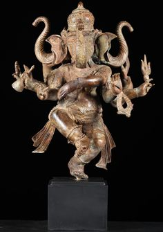 Image from http://www.lotussculpture.com/mm5/graphics/00000001/1-three%20headed%20dancing%20ganesh.jpg.