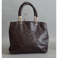 Chanel Brown Caviar Shopper Tote Bag   My wife has had her eye on this bag for some time.  15th Anniversary is on the 28th of February.  She's given us two wonderful children..least I could do is give her a Channel bag, don't you think?  #porteromostwanted