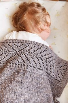 Very sober, gray, subtle texture, simple chevron lace top & bottom band; modern look, sensible, sturdy, no-frills baby blanket. Excellent gift for a baby boy. Little Tern Blanket by Tincanknits, Published in A Year of Techniques