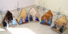 This stained glass nativity set is one of my most popular items at Christmas time. Completely leaded and true stained glass, hand made. The star is made of a glass gem and twisted copper wire, tinned