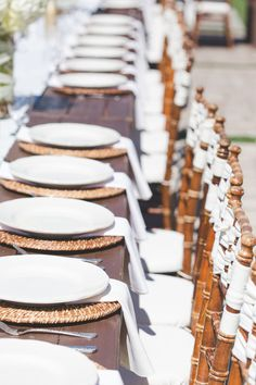 Long family-style tables with simple, neutral, and elegant  place settings {Abbey Lunt Photography}