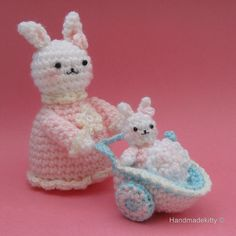 Mommy Bunny with Baby Bunny in Baby Carriage
