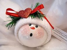Christmas Ornaments: Snowman Ornament craft. LOVE this little face so cute! Great idea to glitter the cheeks too. :-)