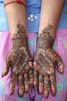 Imagine the time spent creating this henna pattern. The patterns will disappear with in a week or so, but the technique and artistry it takes to make them is artisan work at a high level.