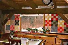 Great idea for using old quilts if we mvoe and I do not have anywhere for them.  Curtains :)