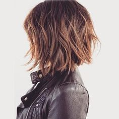 I love this cut! Edgy messy bob...great color.