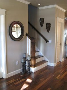 "From another pinner, ""Pretty gray -- sherwin williams ""Pavillion Beige"" I have painted my past three houses this color. I always get asked what the color is. It is a beige grey color. Perfection!!!!!"" Like the staircase, floors, and wall color."