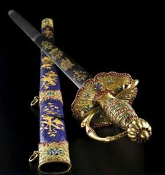 A Rare Jewelled and Canton-Enamelled Gilt-Decorated Sword and Basse-Taille Scabbard with Gold Foils, Qing Dynasty, Jiaqing Period, Circa 1800